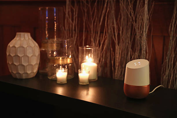 Google Home smart speaker with candles and ornaments