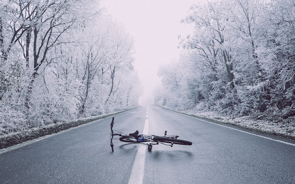 fat bike fallen in the middle of icy road