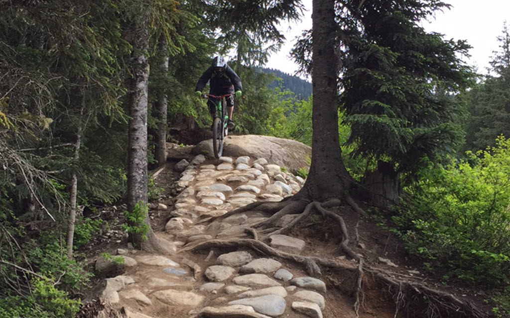 Dan mountain biking in a rock garden in Whistler