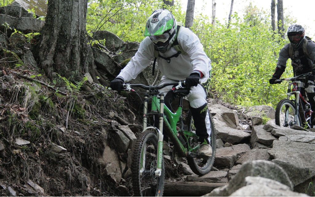 Dan mountain biking in a rock garden in Bromont