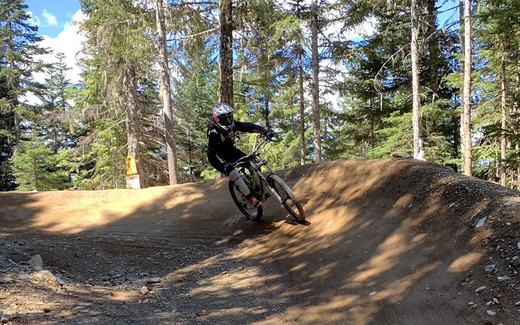 Sophie mountain biking a berm